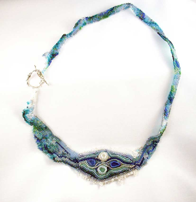 Blue green necklace made from woven seed beads with sea glass and hand made silver fastener